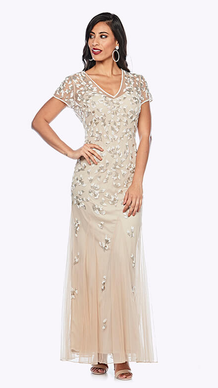 Full-length gown in embroidered chiffon with sweetheart style bodice