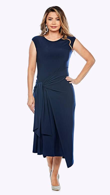 Tea-length sleeveless dress with wrap skirt overlay in stretch fabric