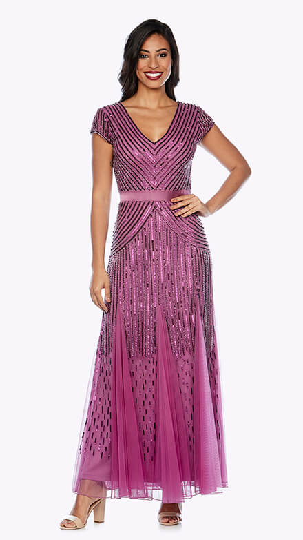 Long cap sleeve beaded gown with satin waistband and fishtail skirt