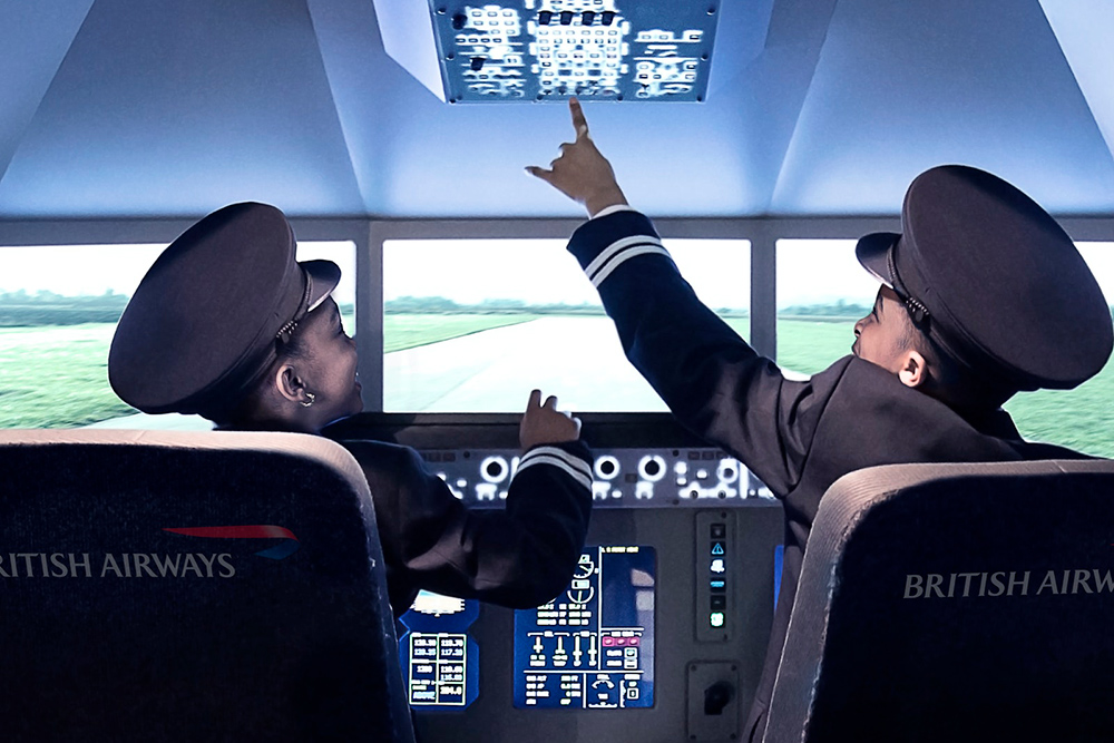 Two boys learning how to be pilots.