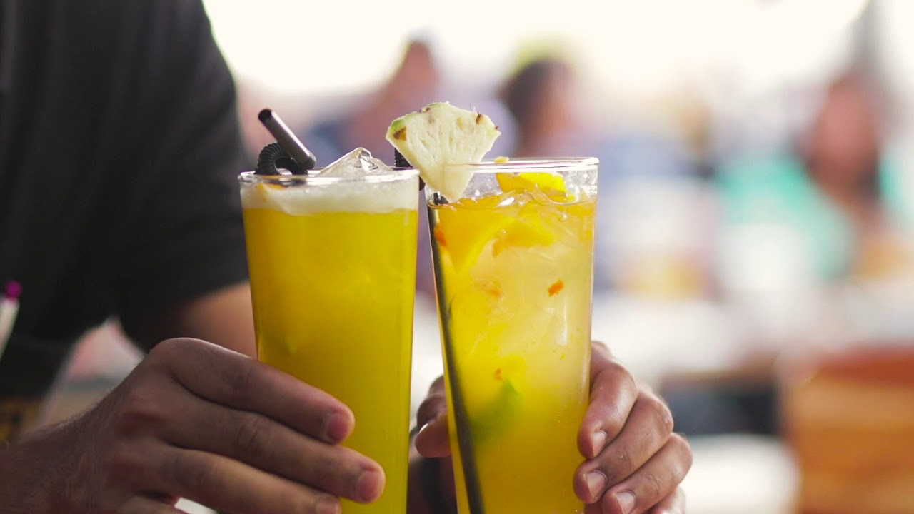 Food and beverages. Man holding two glasses of drinks