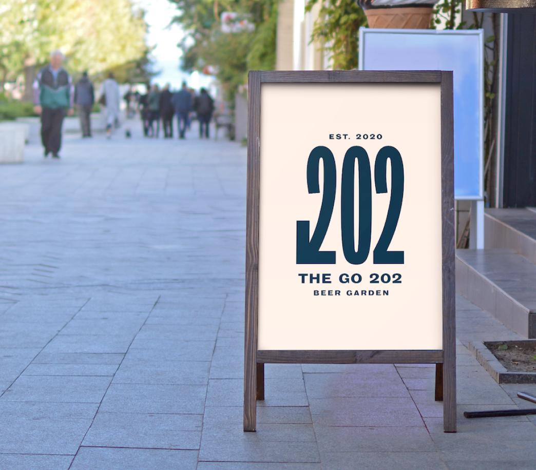 The Go 202's logo on an outdoor sign