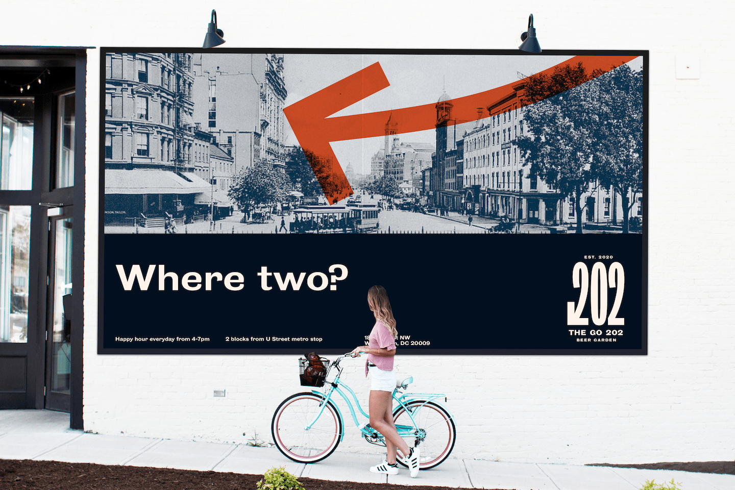 Girl riding bicycle in front of a billboard advertisement for the beer garden