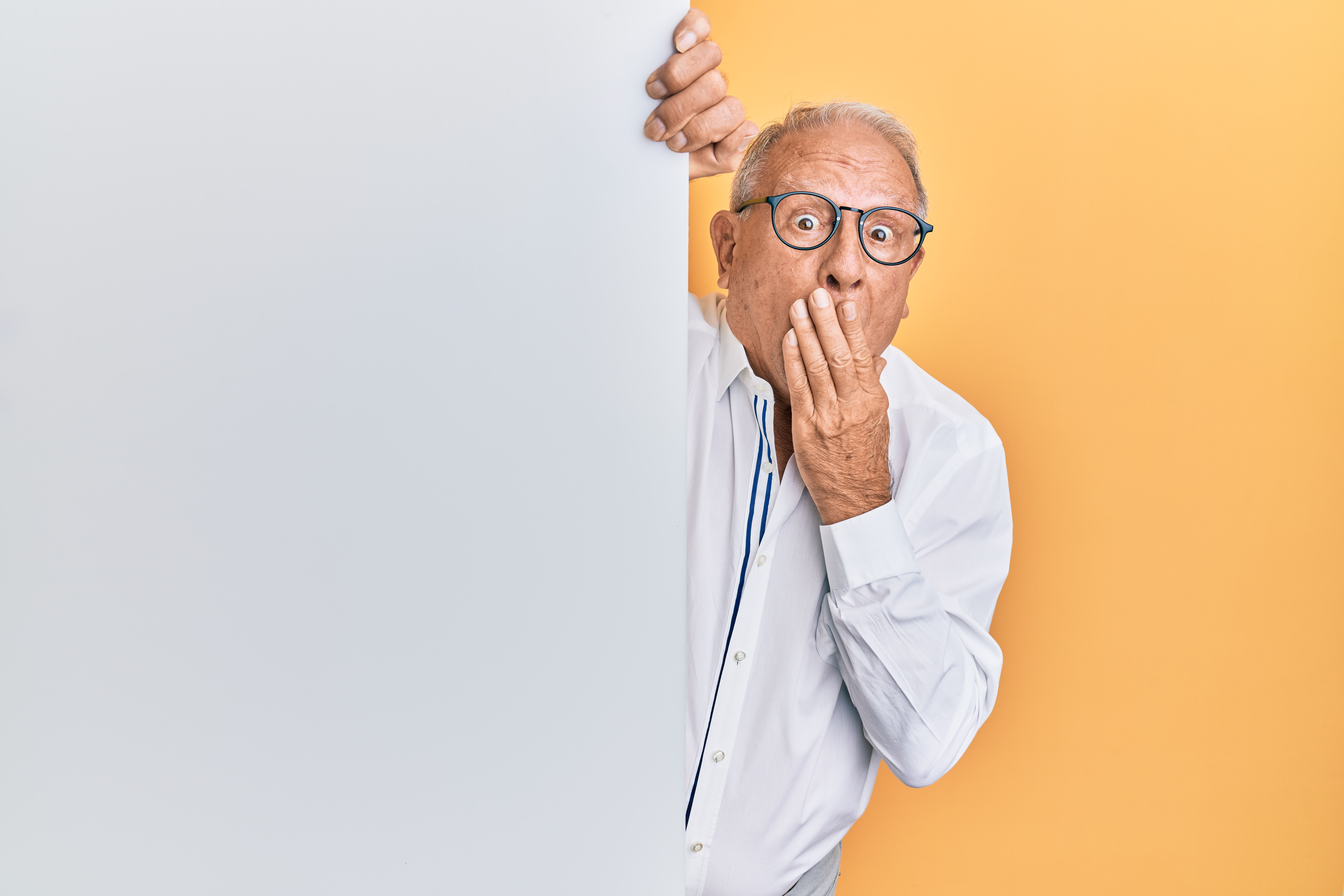 A man covers his mouth due to shock.