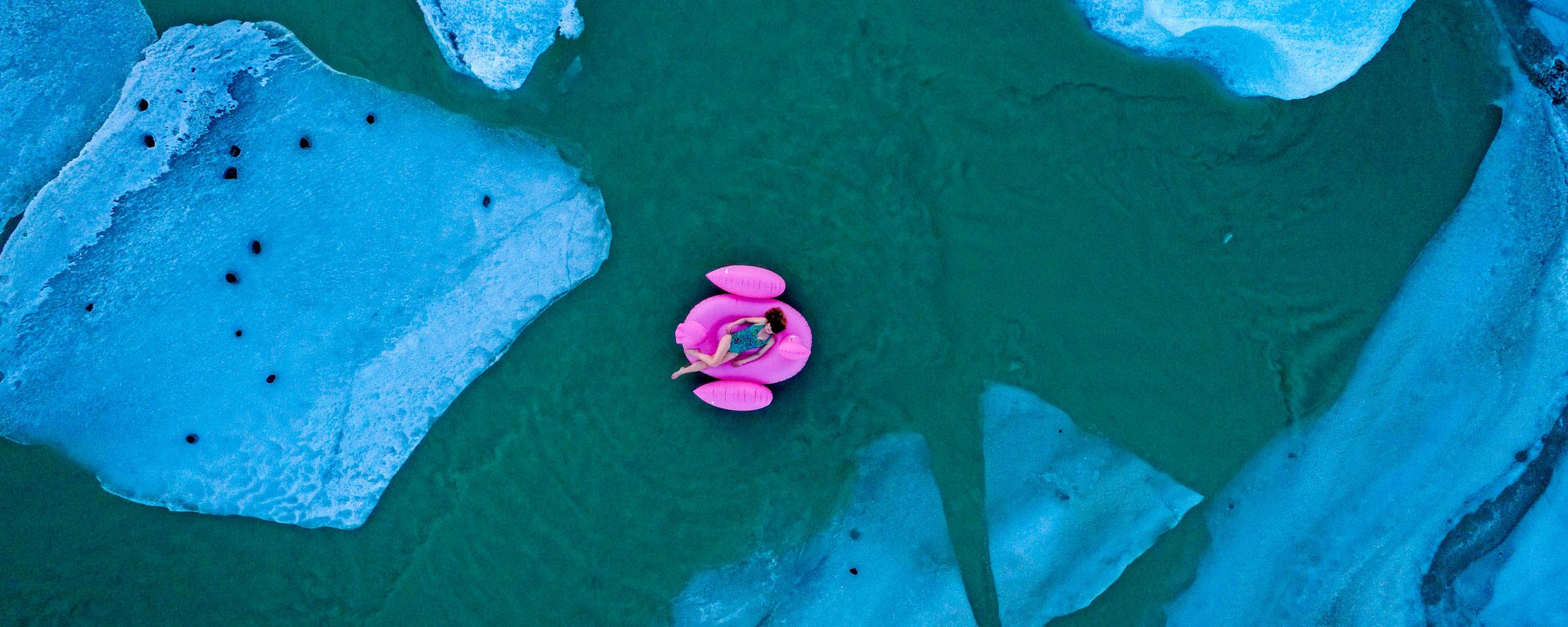 ©KontraPixel girl on a flamingo floating in glacier lagoon