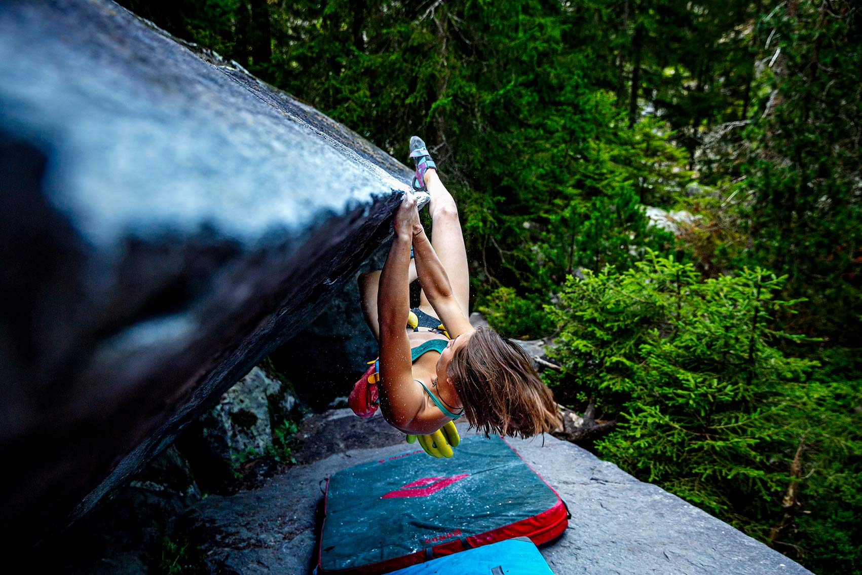Climber girl hanging from wall