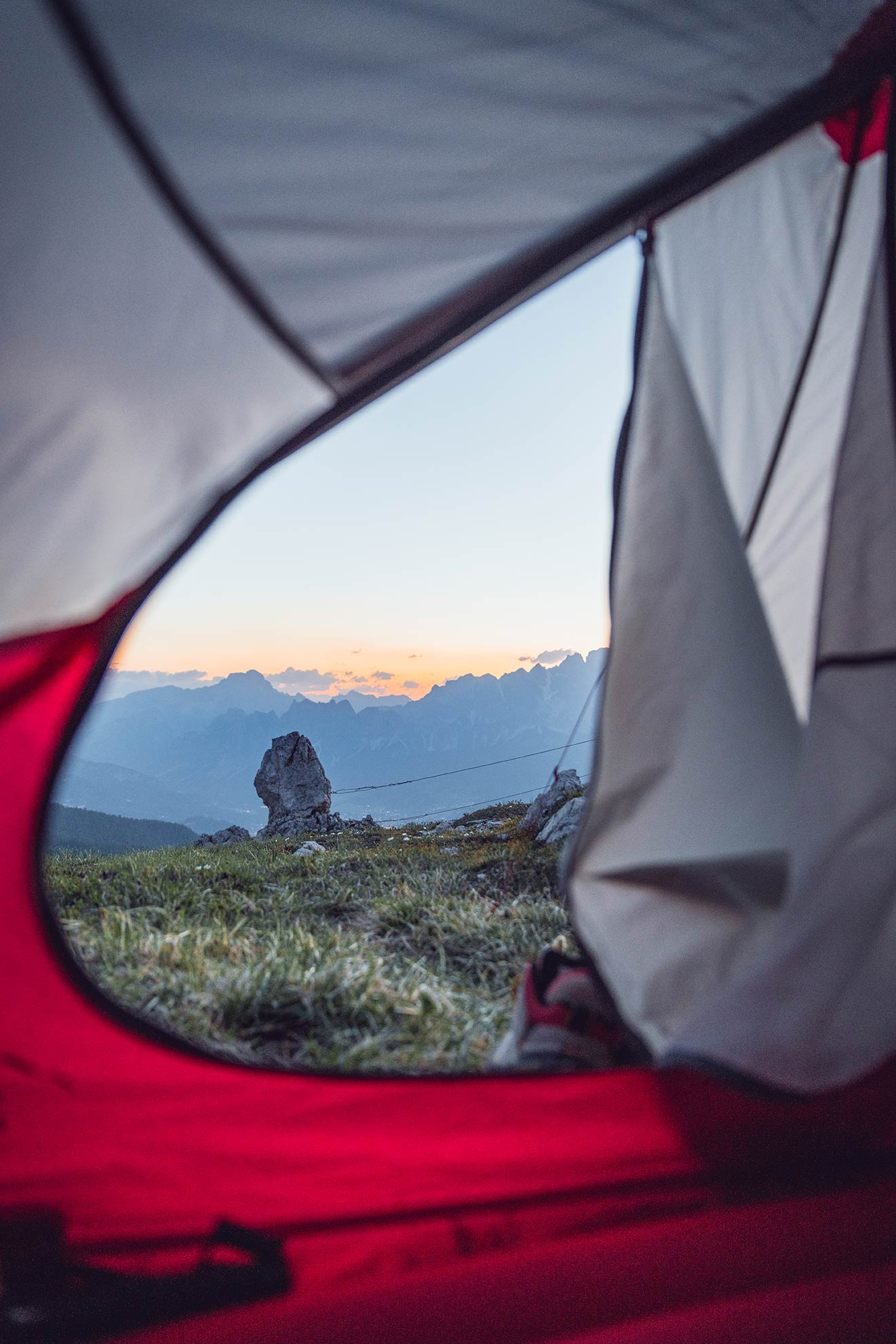 ©Miriam Mayer view from inside the tent onto sunset up in the mountains