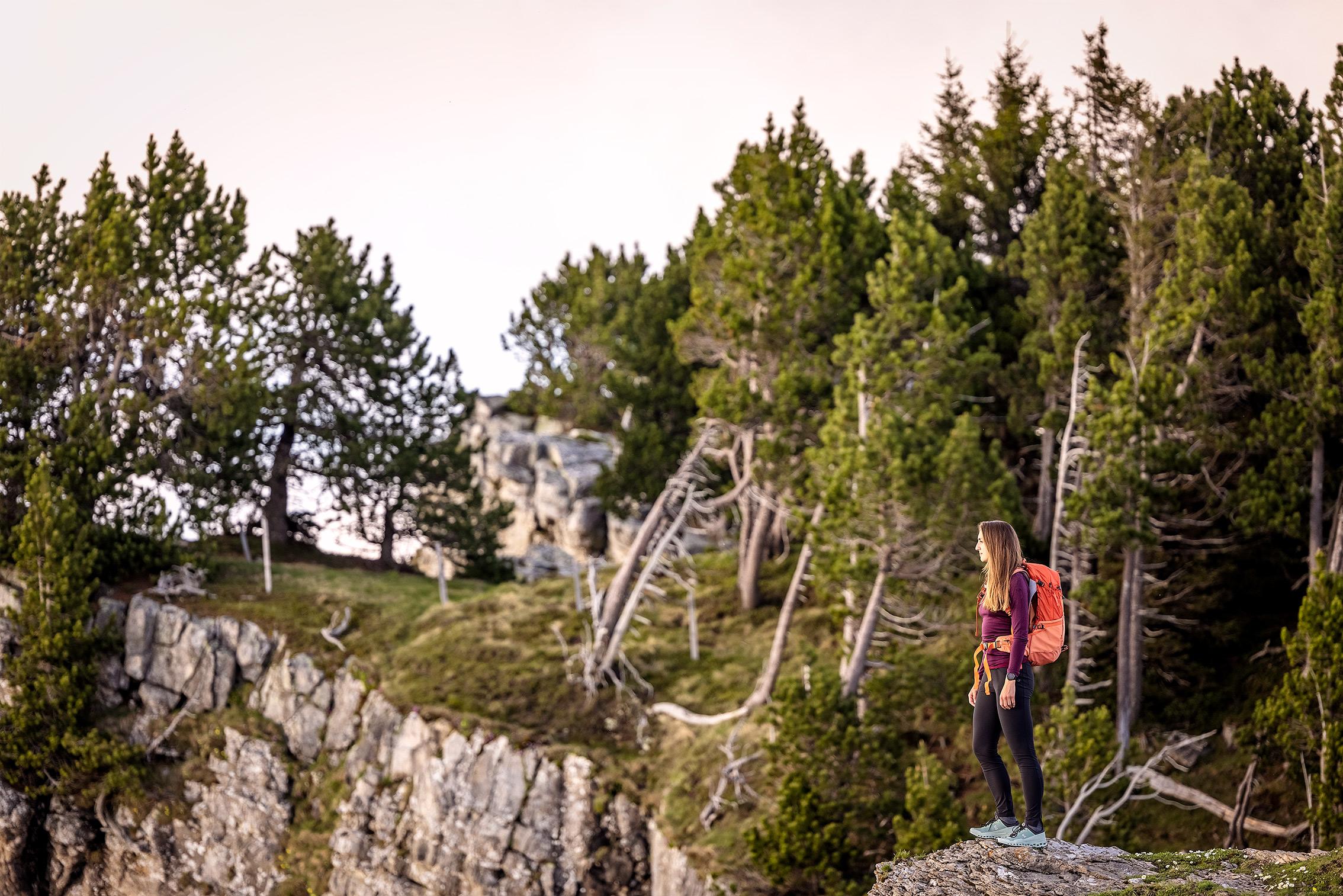 girl standing on mountain edge