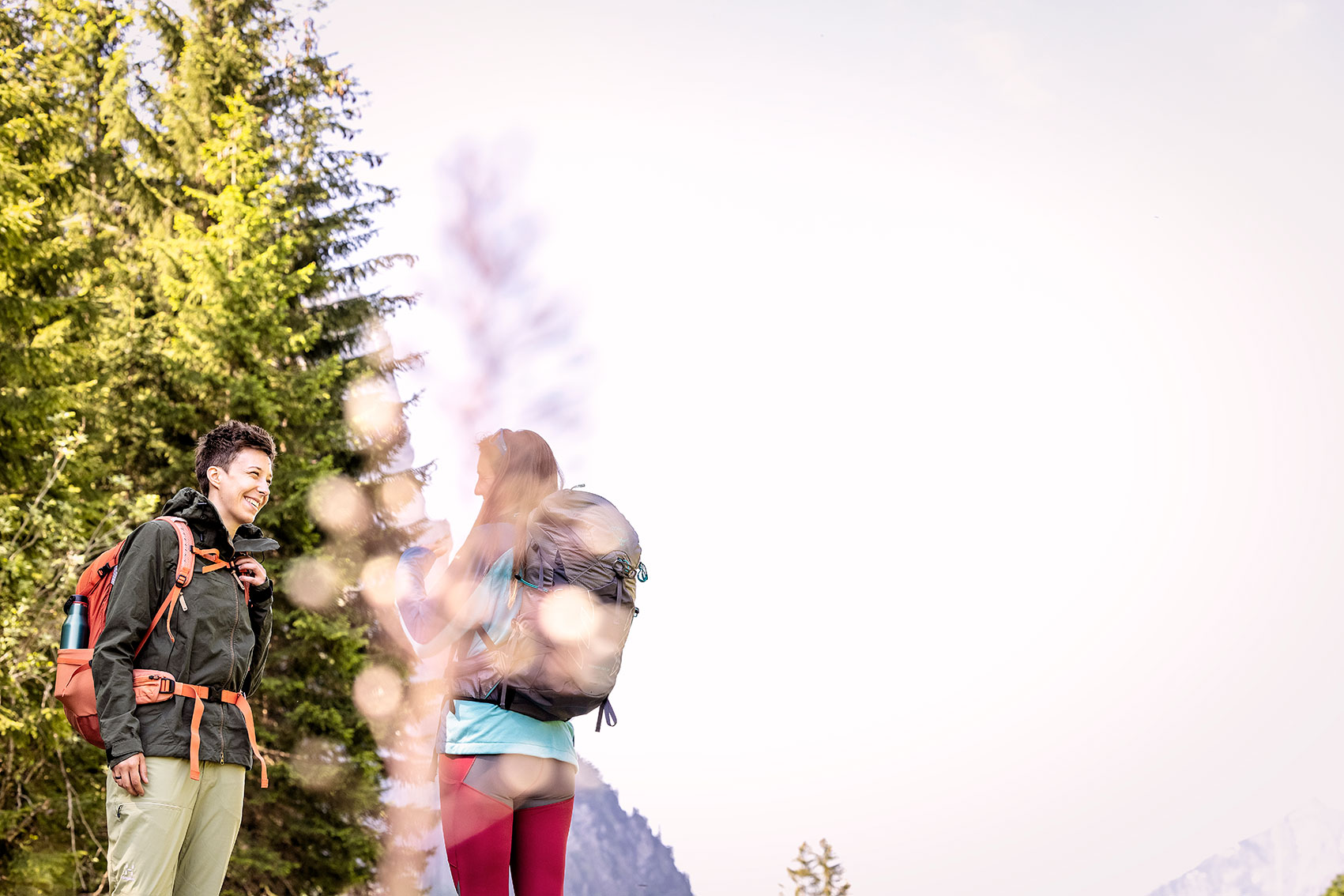 Girls chatting and laughing in the mountains
