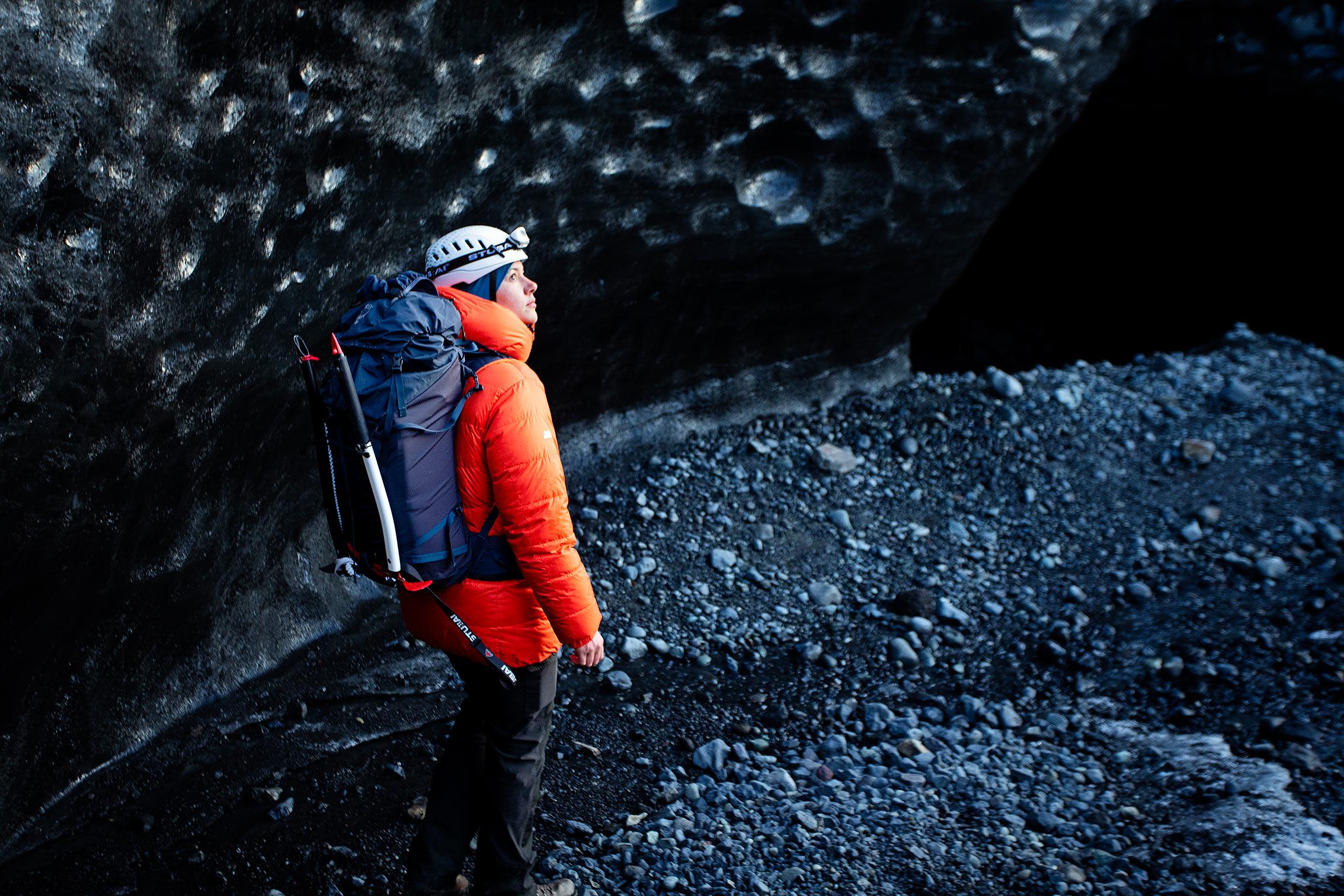 woman hiking on a glacier with black ice ©KontraPixel