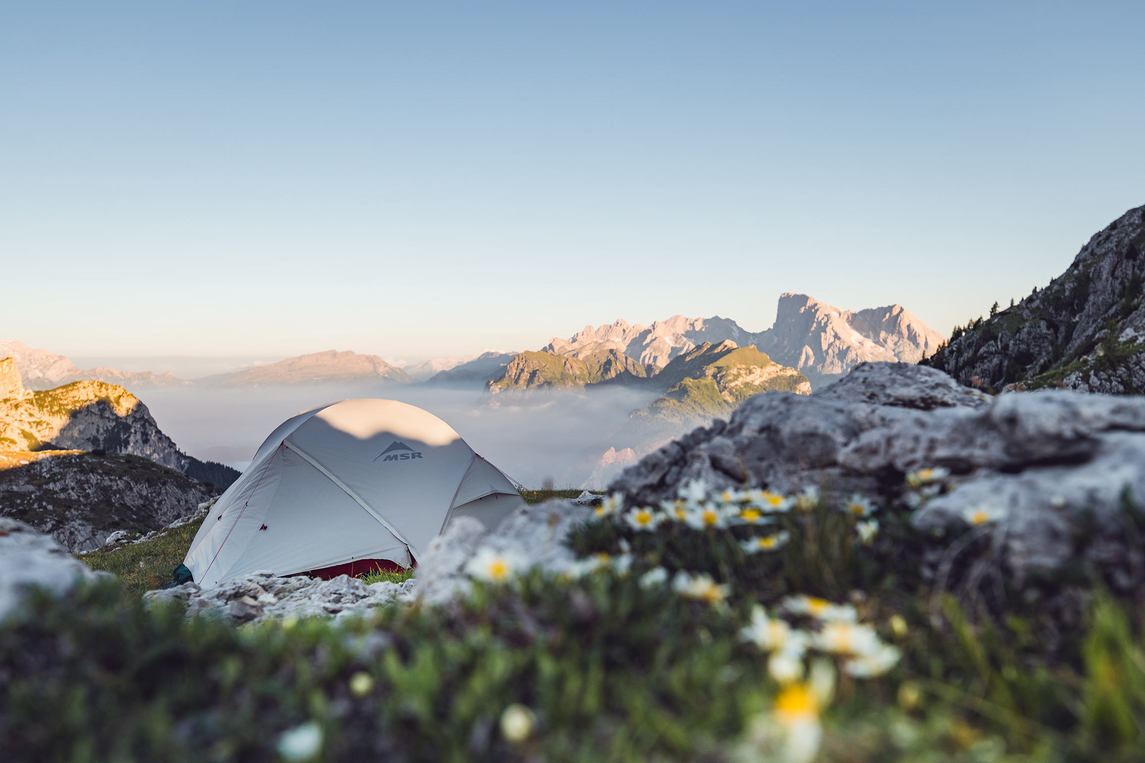 Tent rigged up in the mountains in the setting sun ©Miriam Mayer