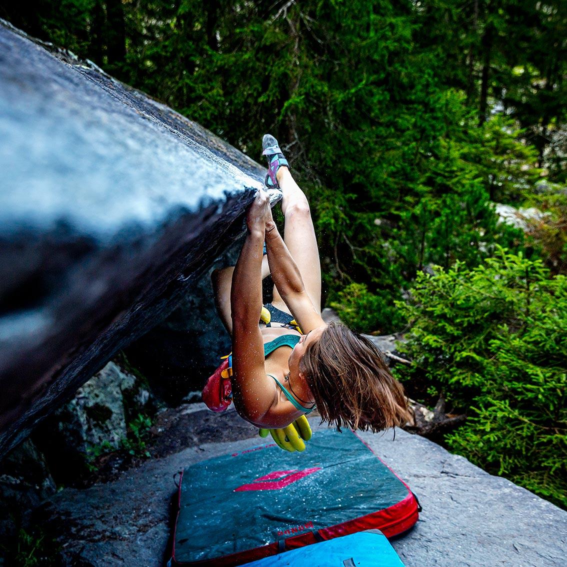 header image girl climbing on rock cliff