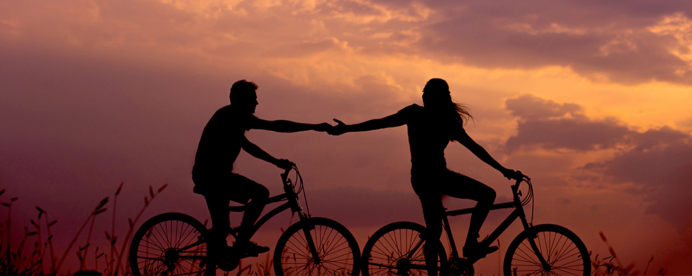 Couple holding hands on sunset