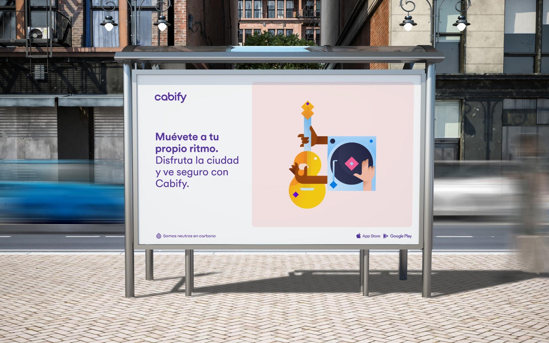 """Anuncio en la calle que dice """"Muévete a tu propio ritmo. Disfruta la ciudad y ve seguro con Cabify"""" junto a una ilustración de música"""