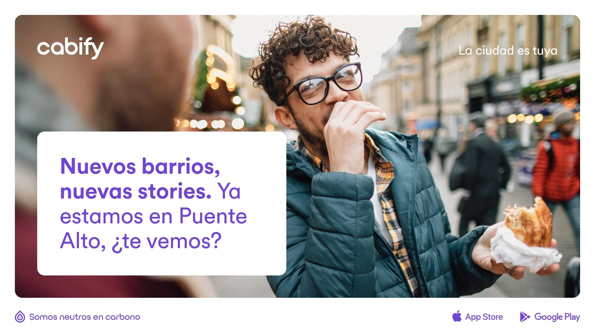 """Un anuncio con el texto """"Nuevos barrios, nuevas stories. ya estamos en Puente Alto, ¿te vemos? y la foto de fondo de un chico comiendo comida en la calle"""