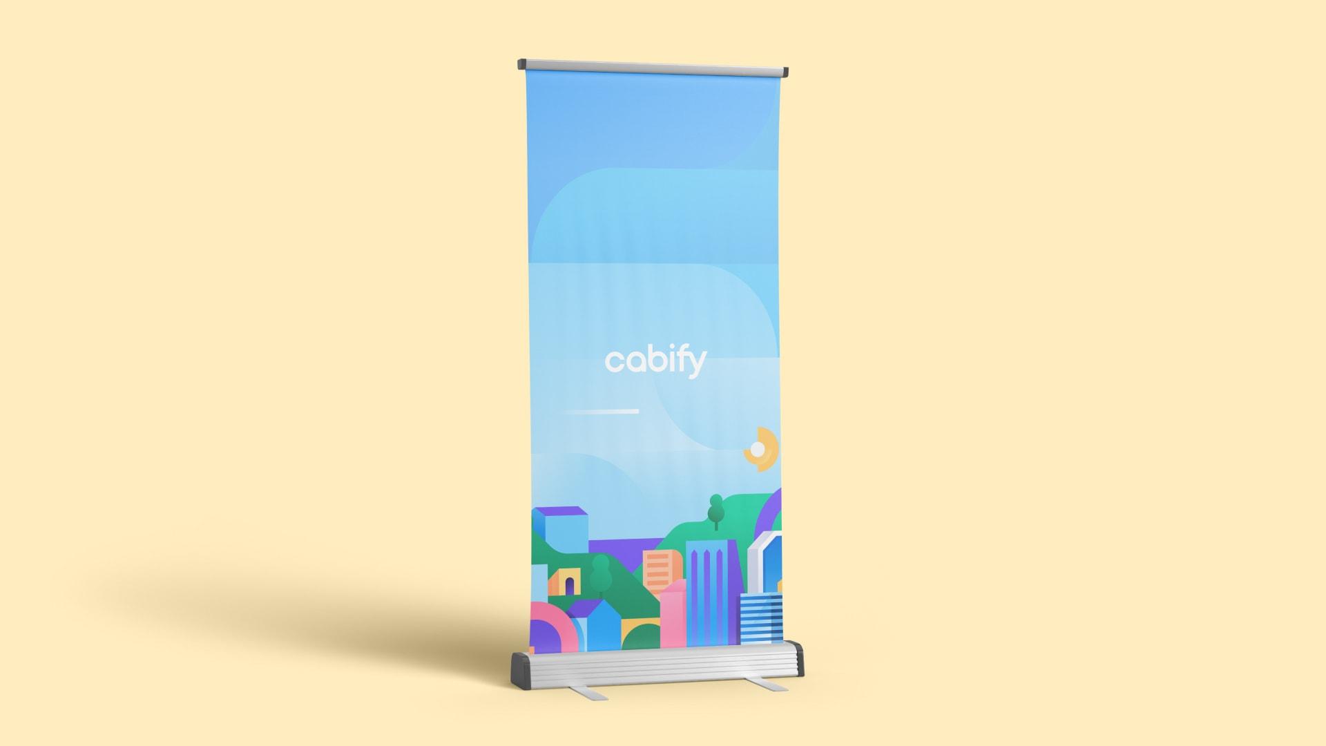 Un roll up con la ilustración de una ciudad y el logo de Cabify
