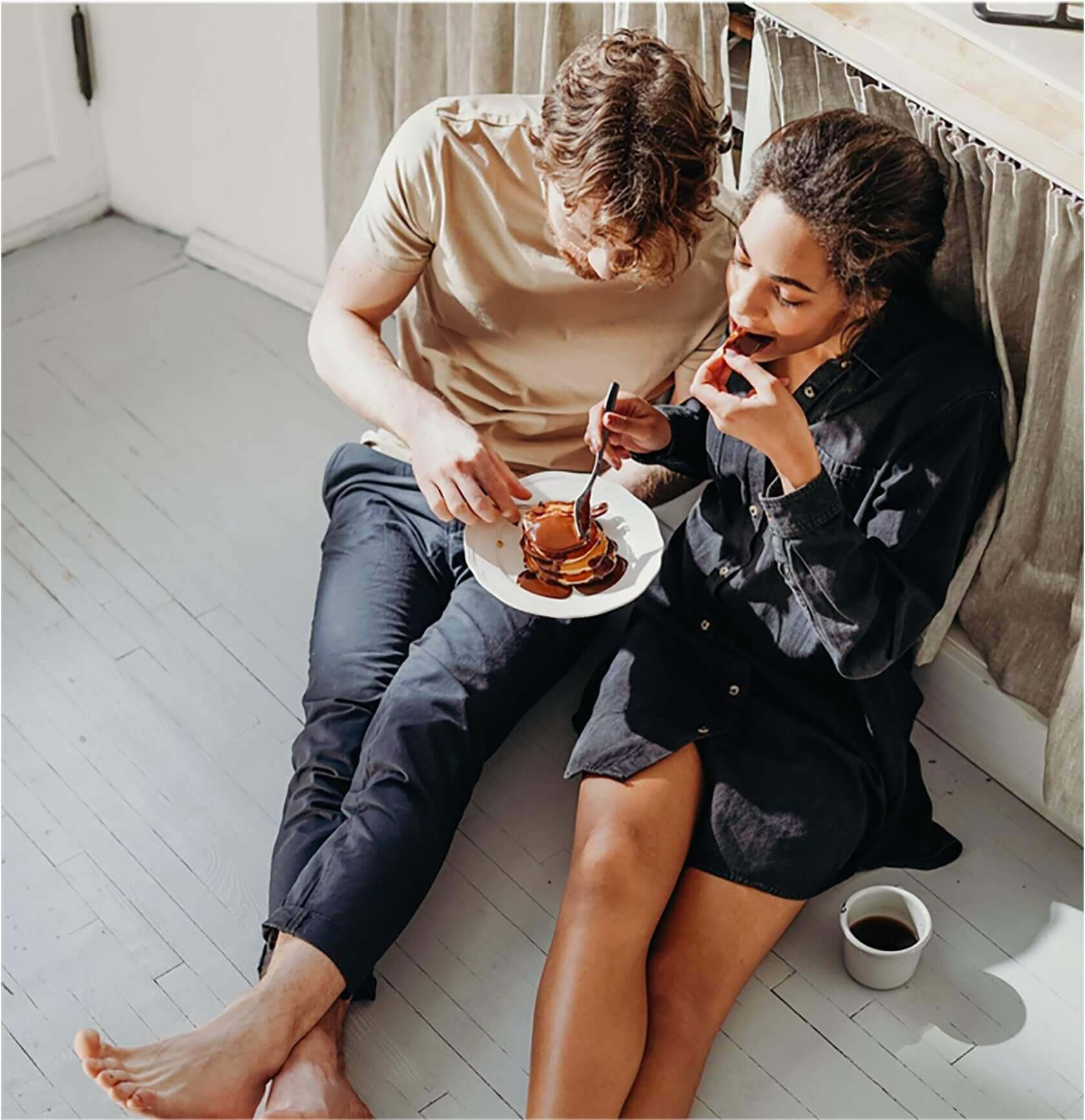 Two people enjoying a desert together