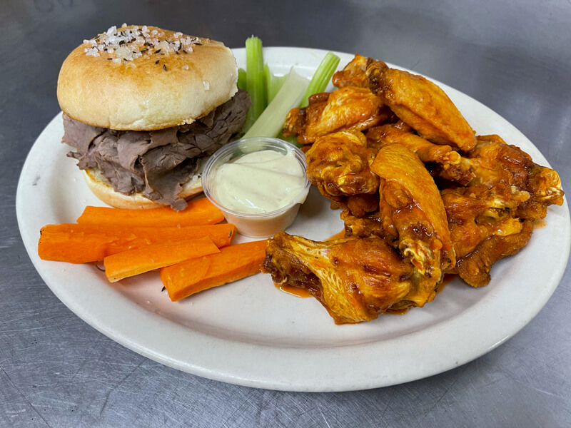 Beef on weck sandwich and chicken wings.