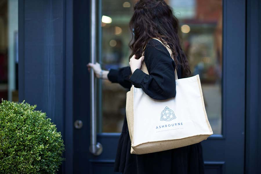 Lady wearing an Ashbourne town bag