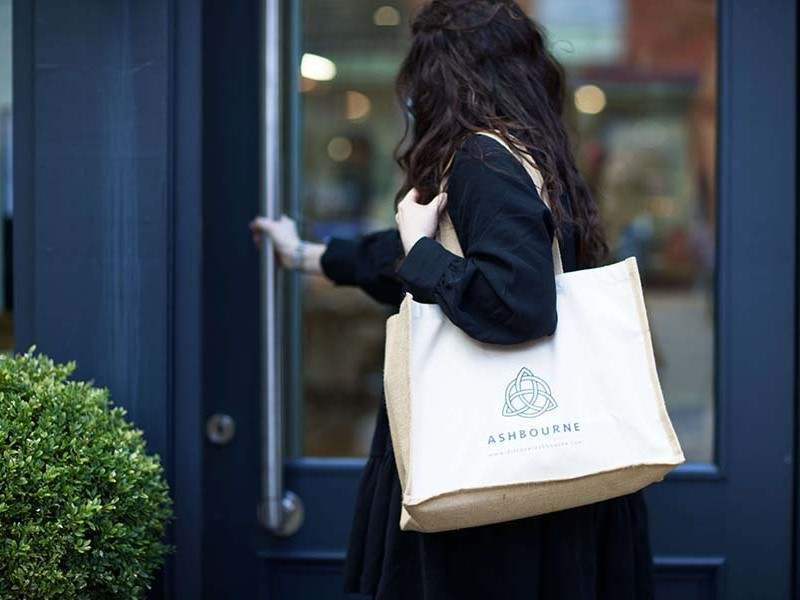 Lady carrying an Ashbourne town bag