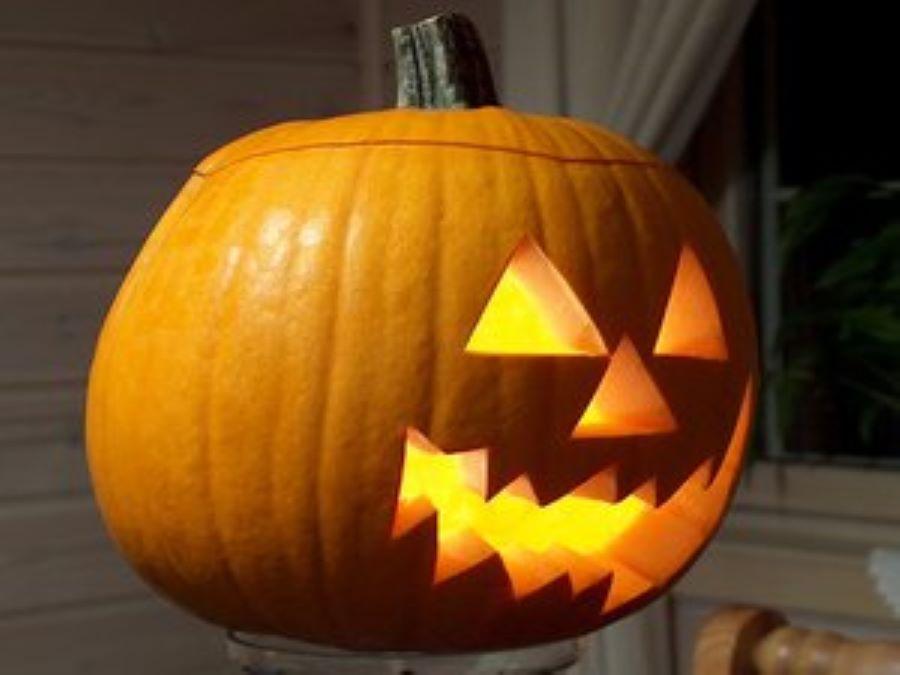 seasonal carved and lit pumpkin