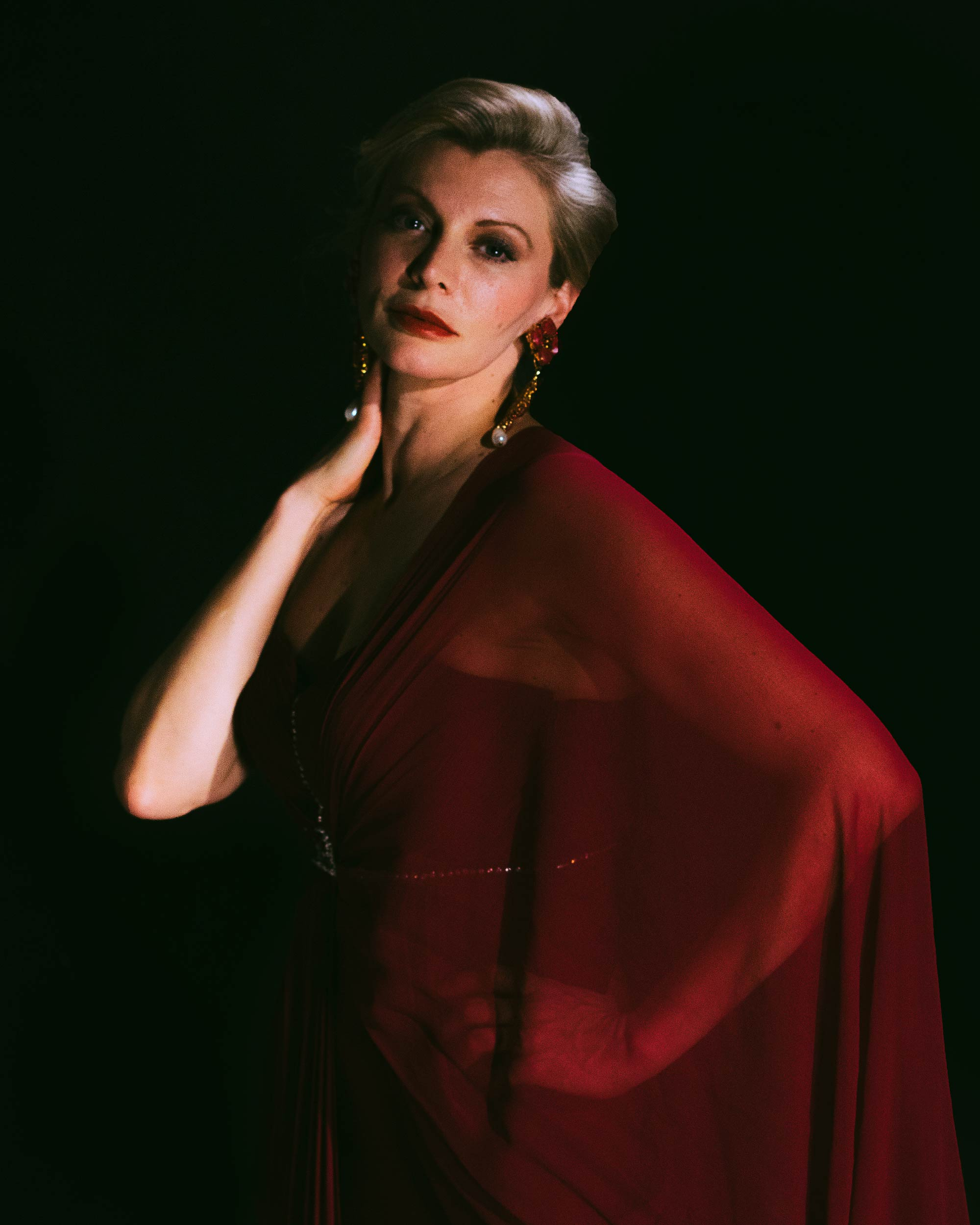Makeup for London fashion shoot. Woman in red dress and shawl poses for photo (2).