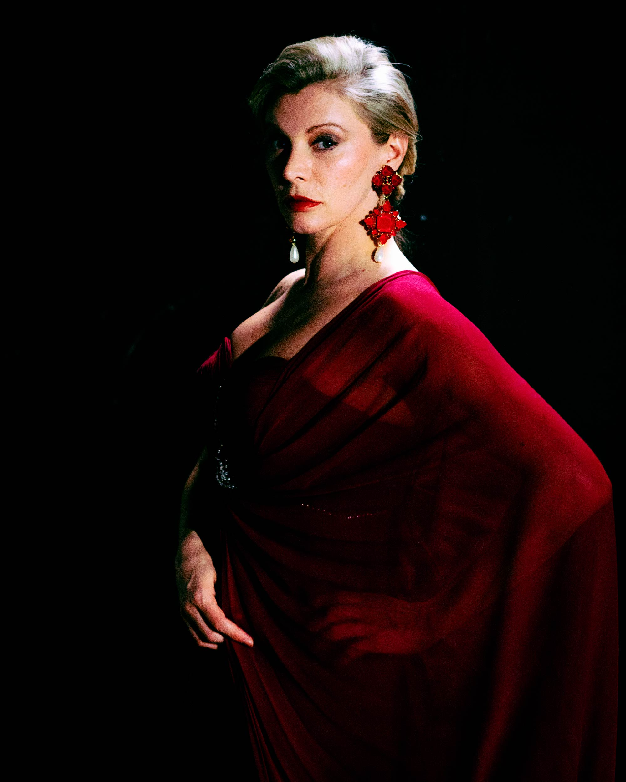 Makeup for London fashion shoot. Woman in red dress and shawl poses for photo (3).