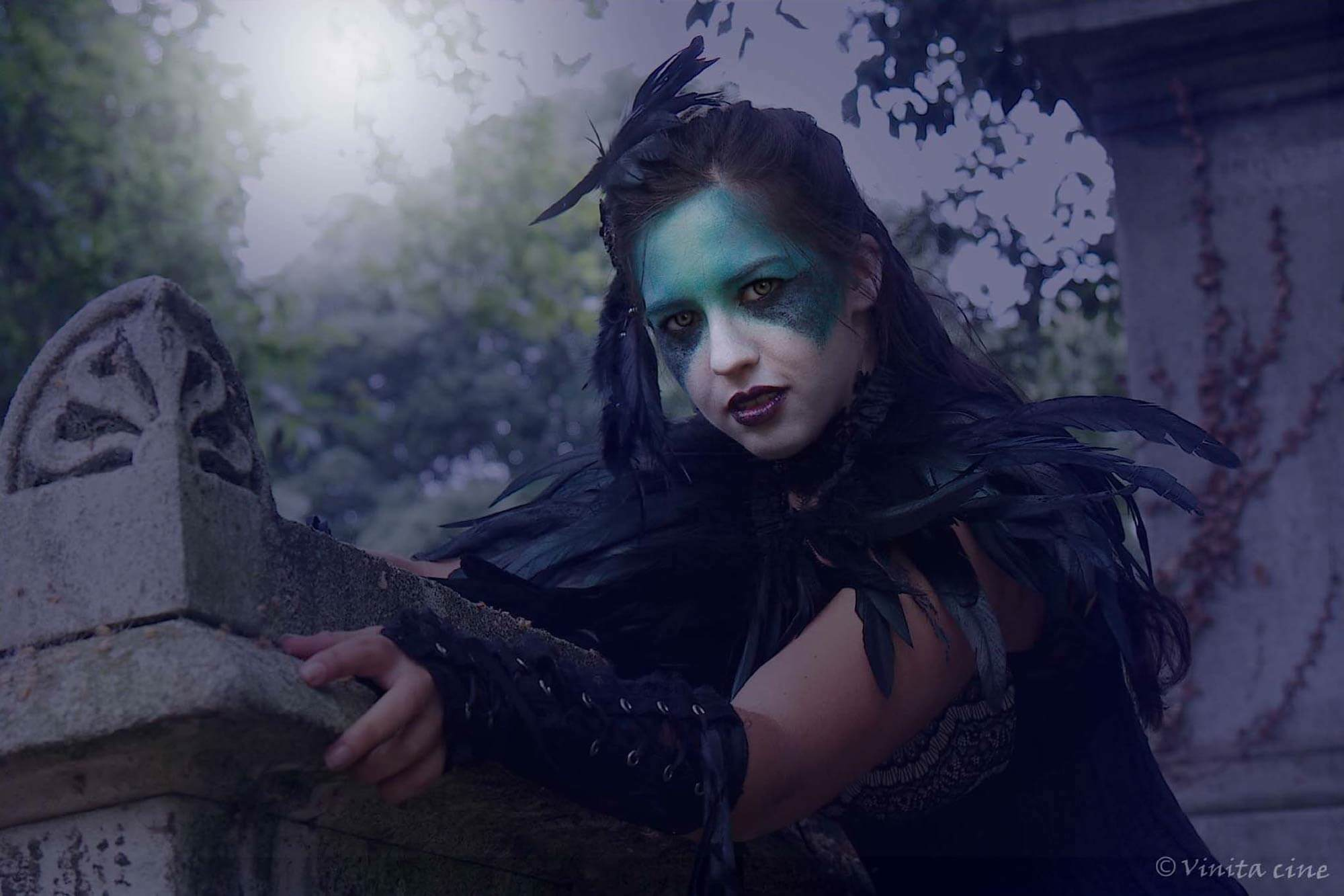 Fantasy makeup. Gothic girl poses for photo.