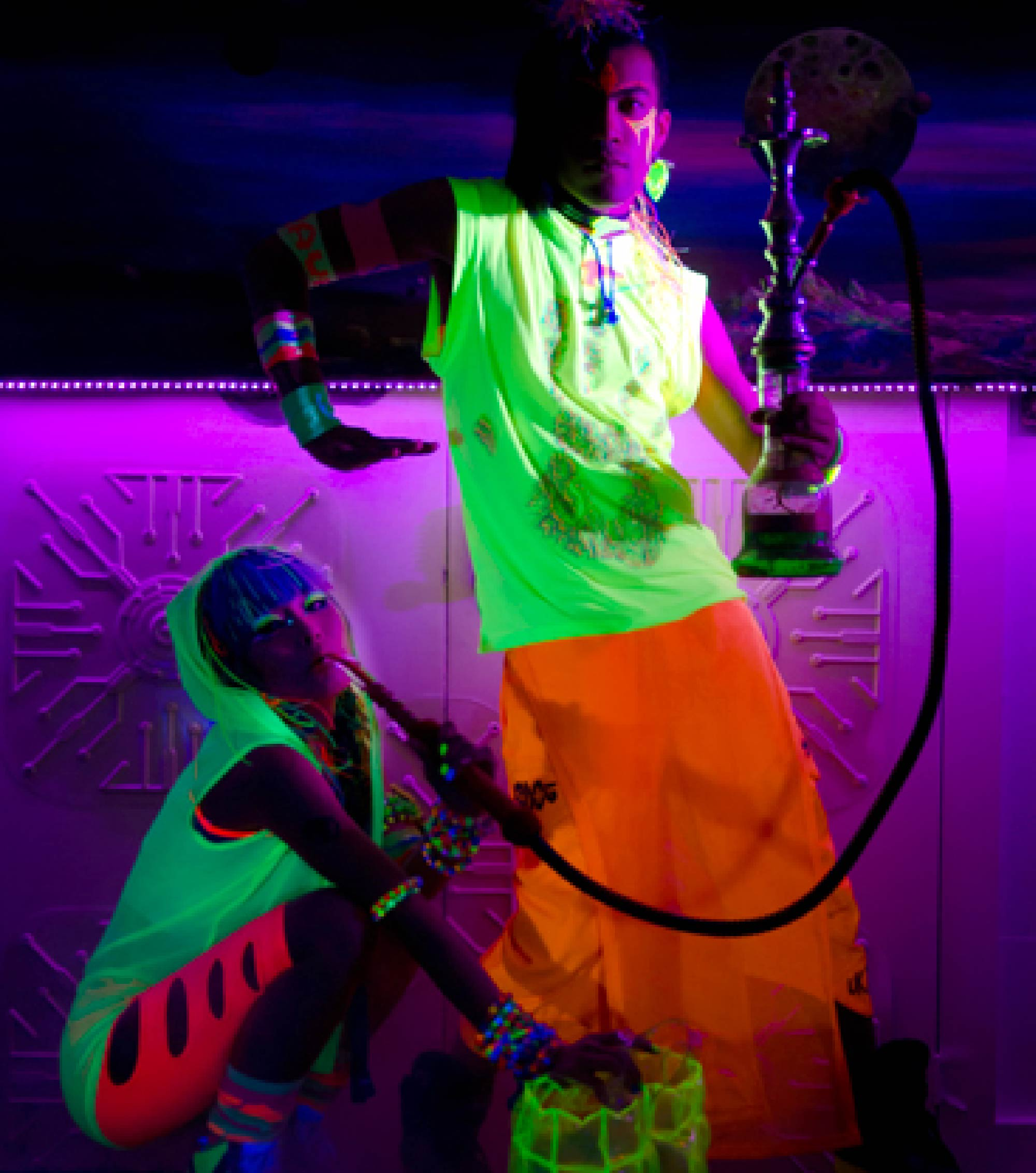Makeup for London music video. Man with fluorescent clothes and paint poses under a blacklight (2).