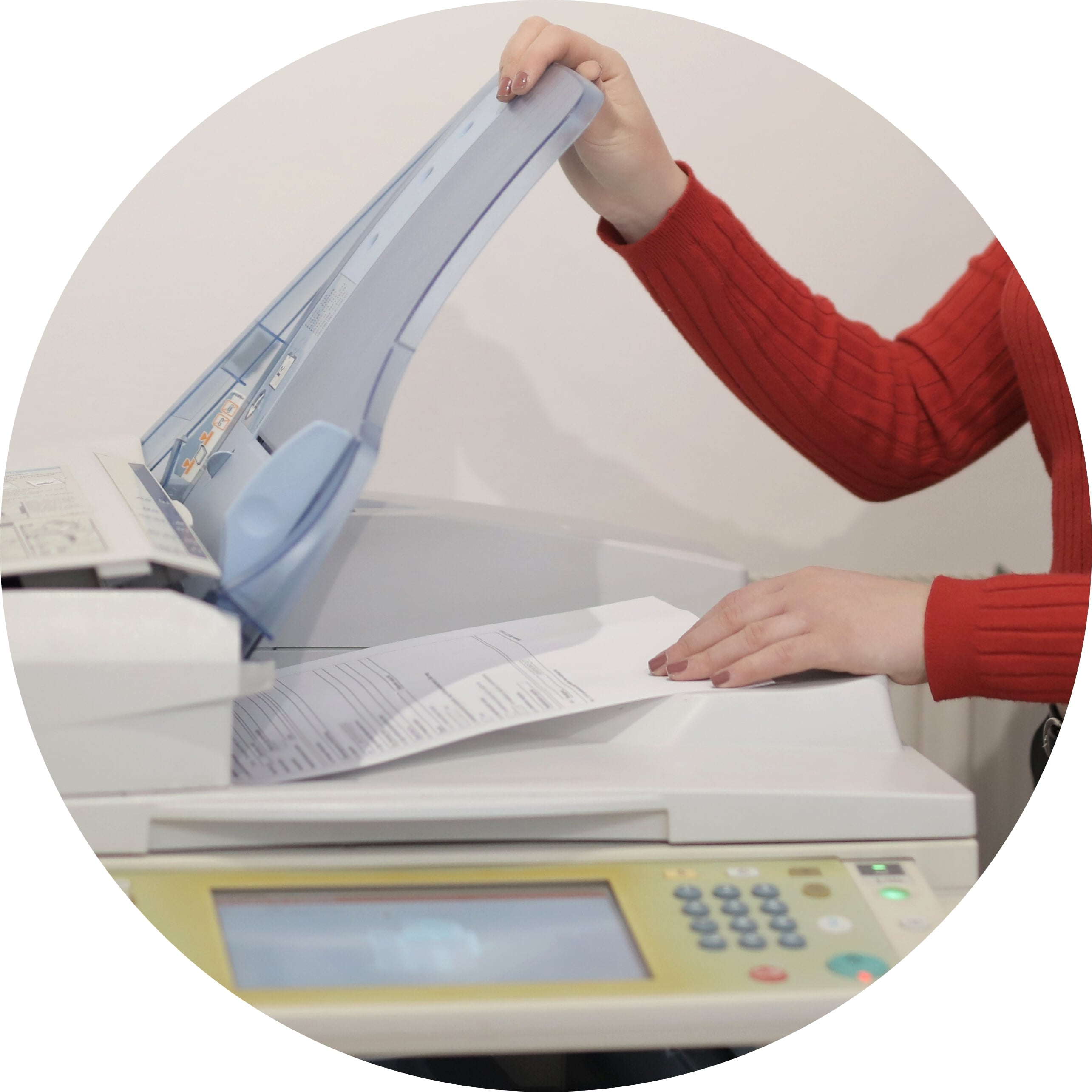 A lady printing off her Will.