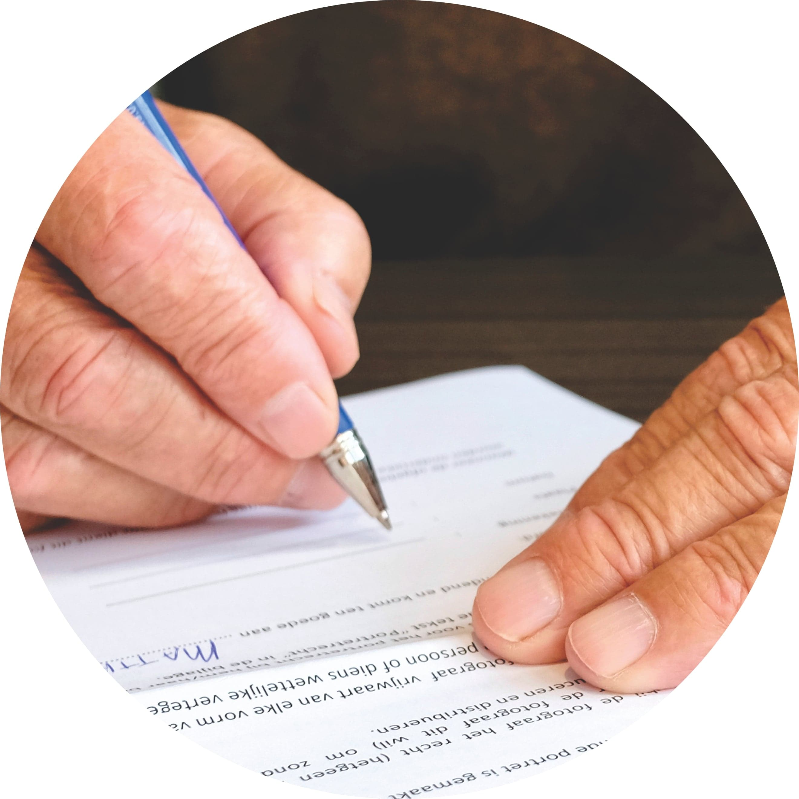 A man signing his Will.