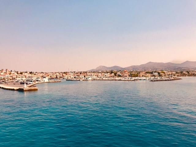 view of the main port of Aegina in Saronic gulf of greece during sunset