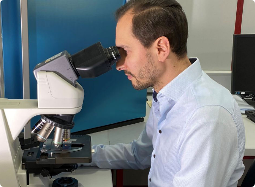 Image of Mindpeak CEO looking through a microscope