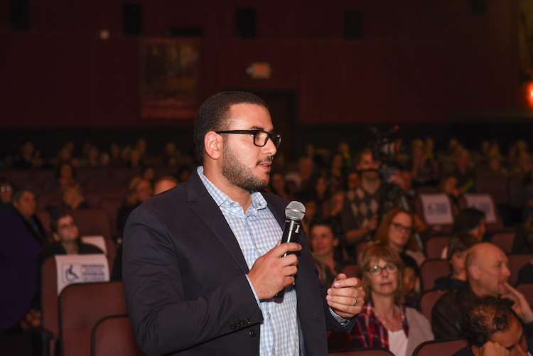 Audience Member asking a question at Screenagers Community Screening Event