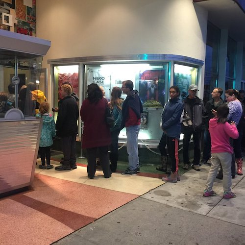 People queuing outside cinema