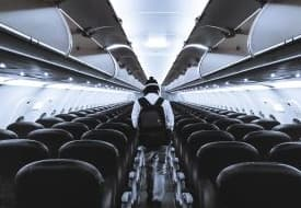 A man on an empty airplane