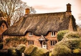 a red brick thatched cottage