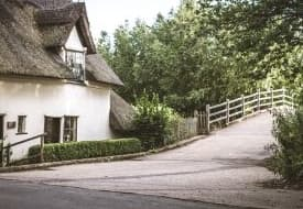 A thatched cottage on a lane