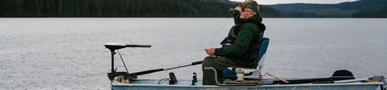 a man fishing on a lake