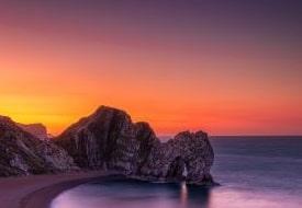 A sunset picture of durdledoor in Dorset