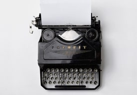 A black and white image of a typewriter on a plain white background