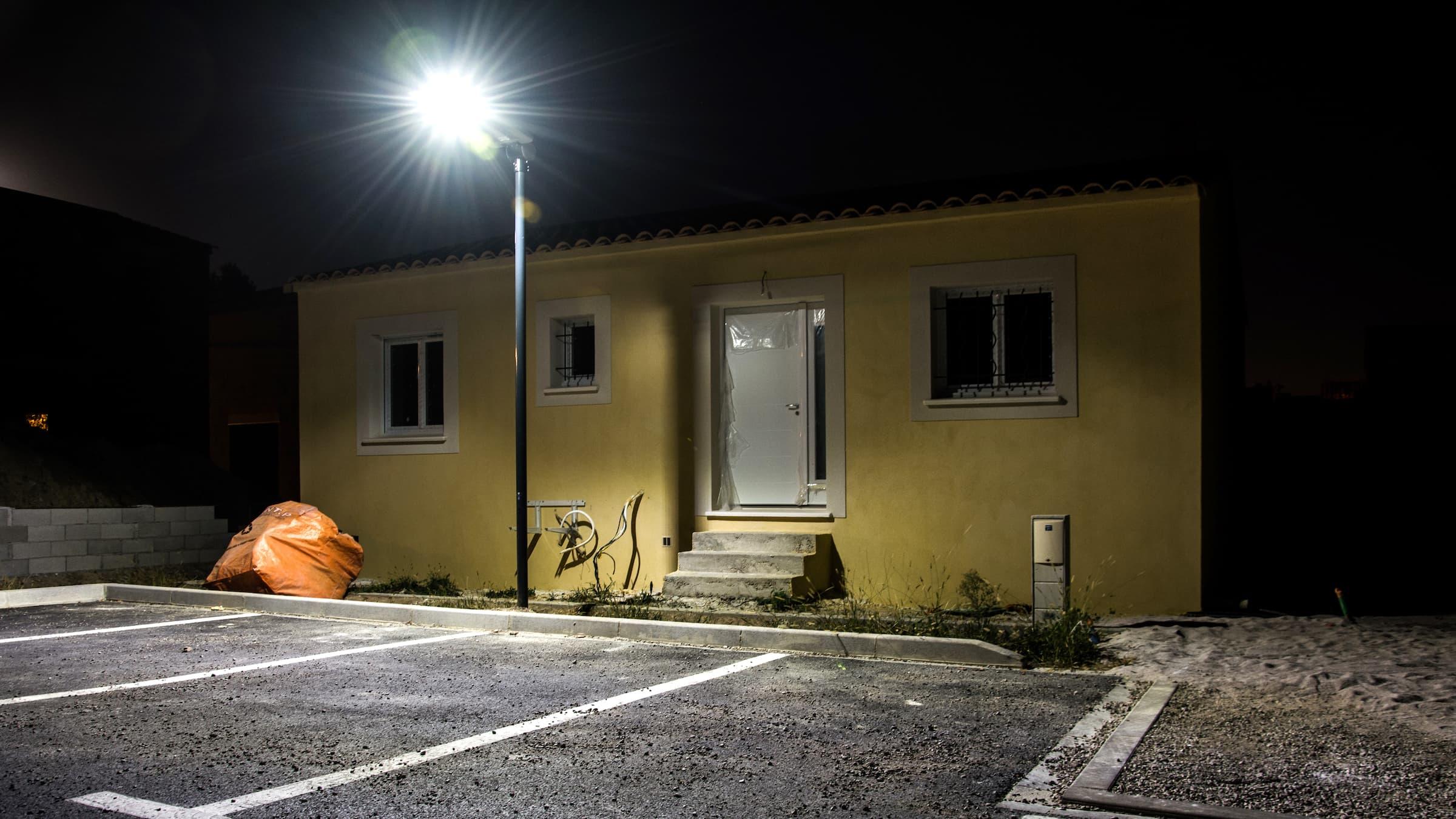 solar street light installation in a traditional village in France