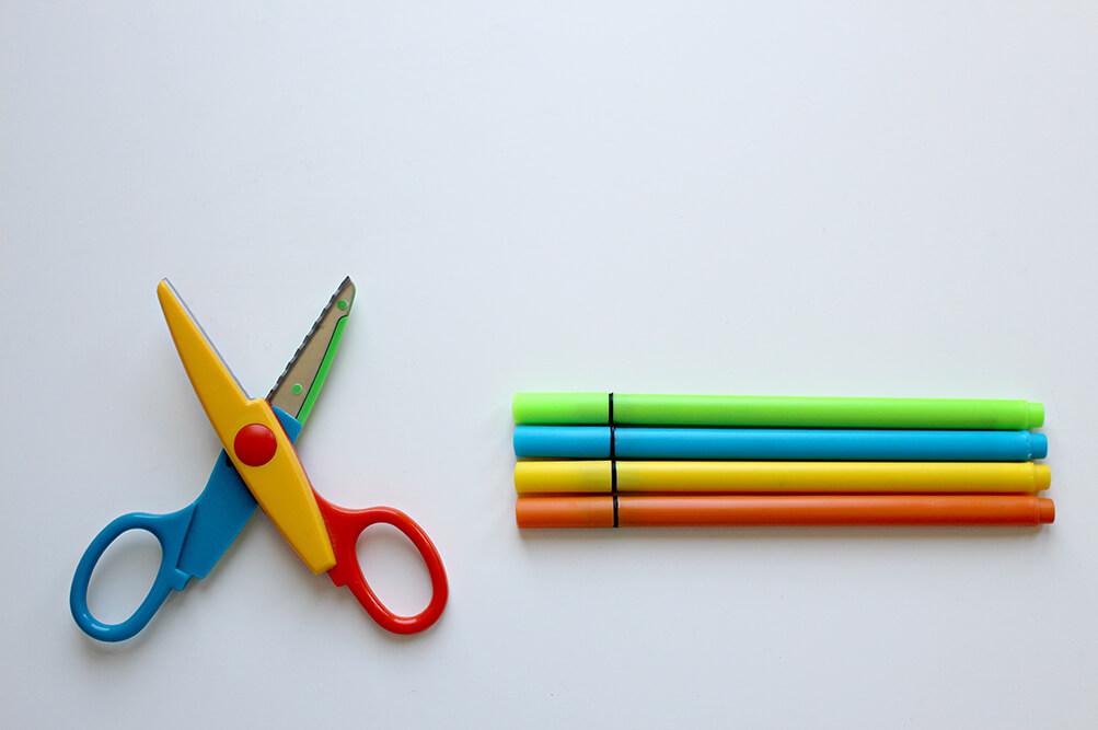 Children's scissors and colored pencils.