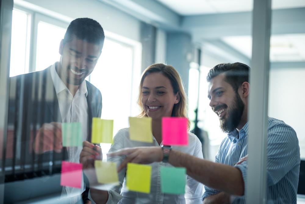 Team discussion design thinking workshop remote workforce