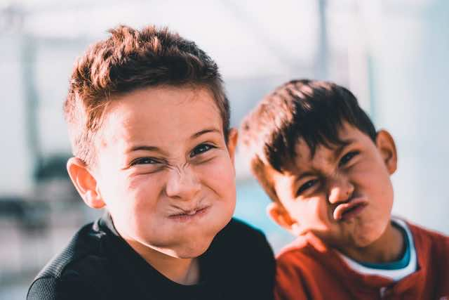 Two kids making funny faces