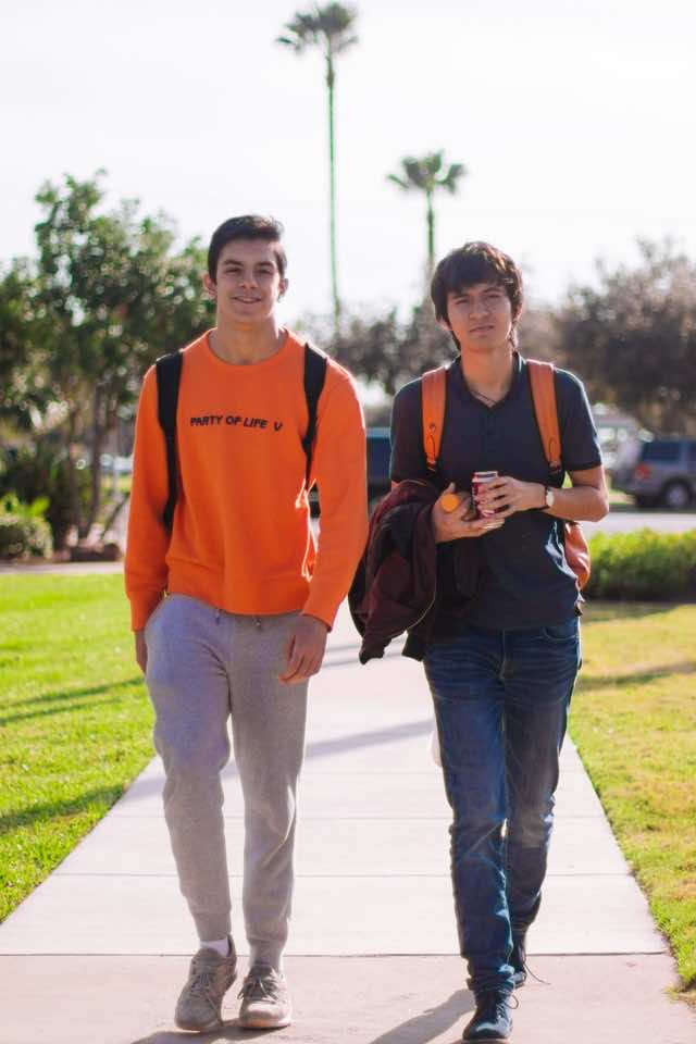 Two teenagers wearing orange