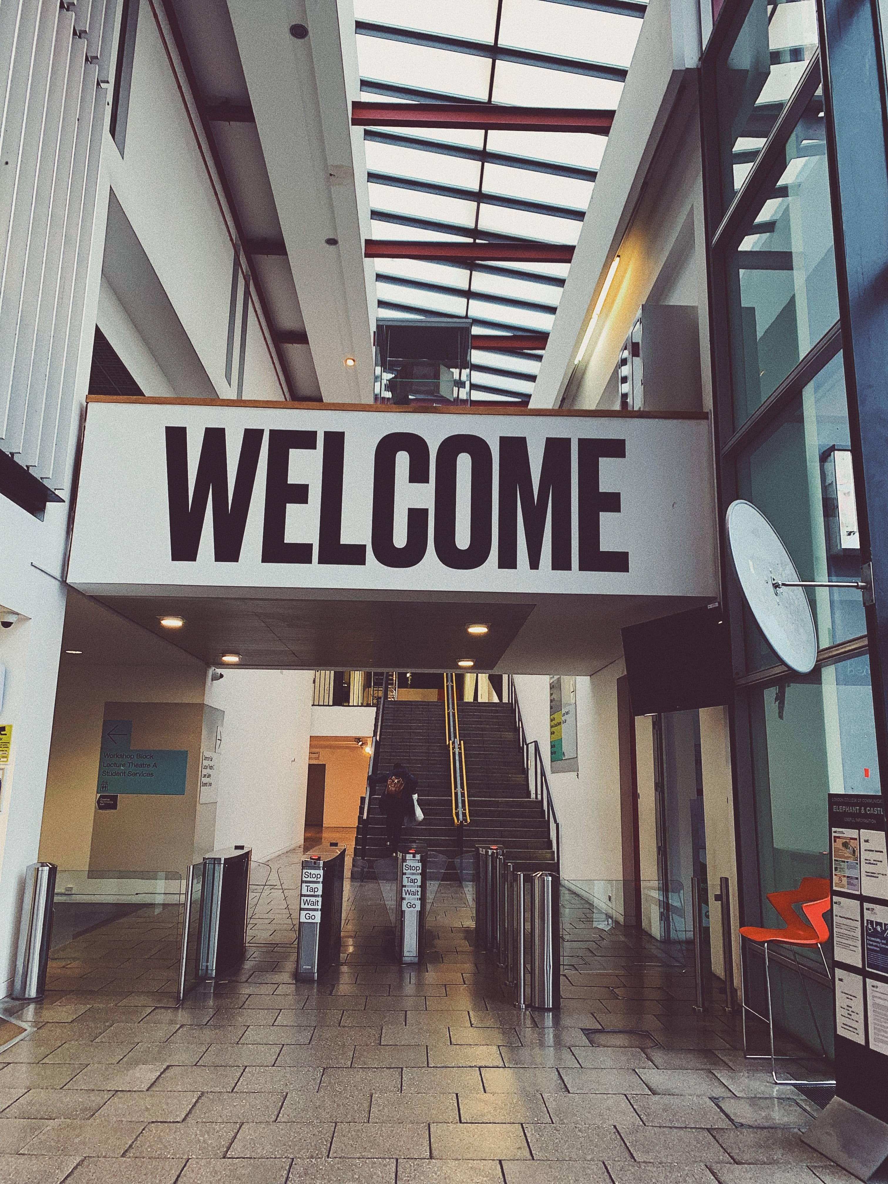 A large welcome sign in the entry of a building