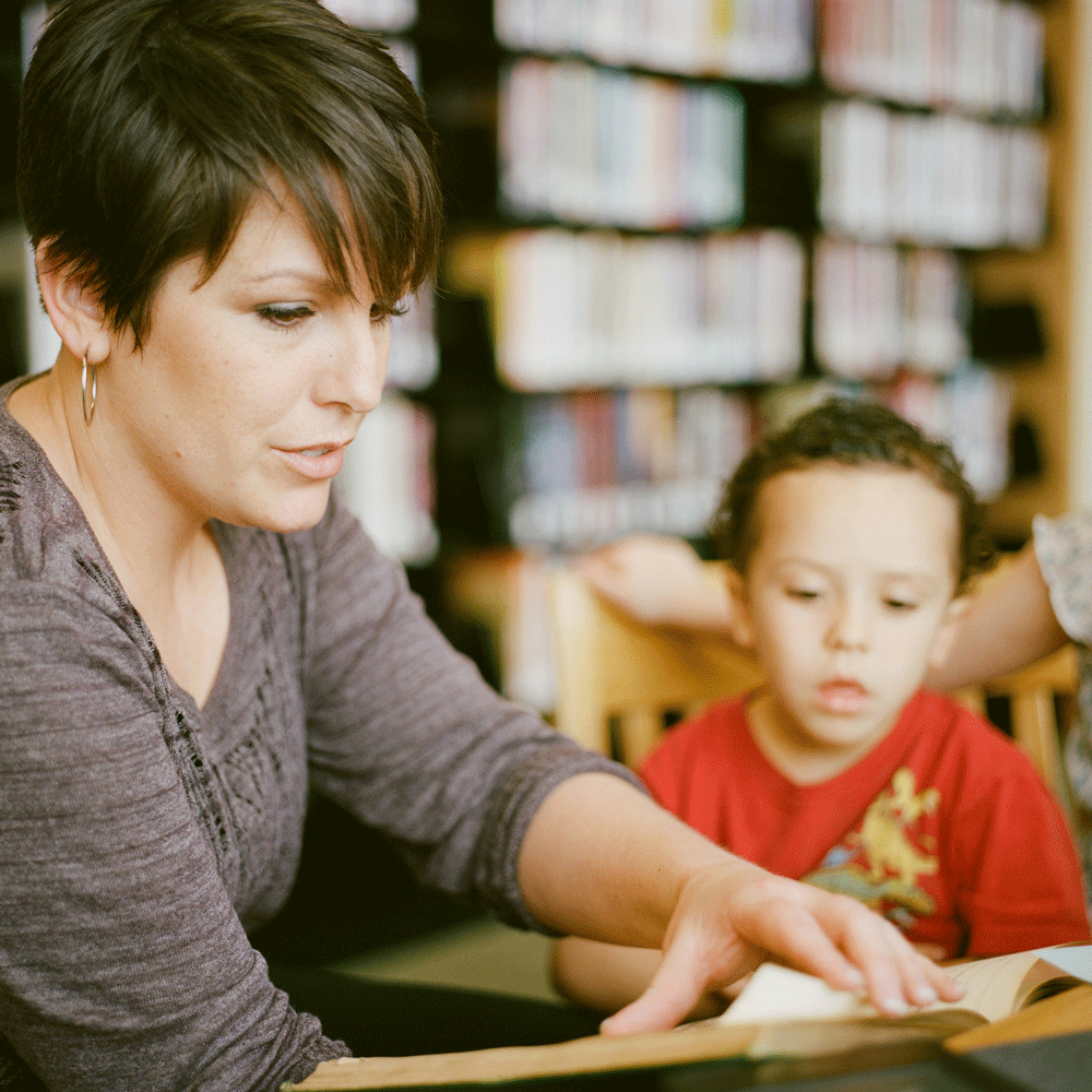 Behavioral professional  working with a child.