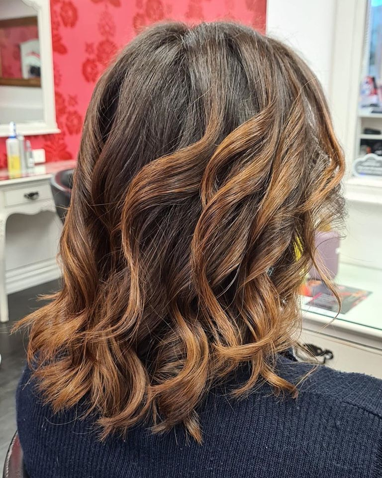 Brown curled hair after fixed
