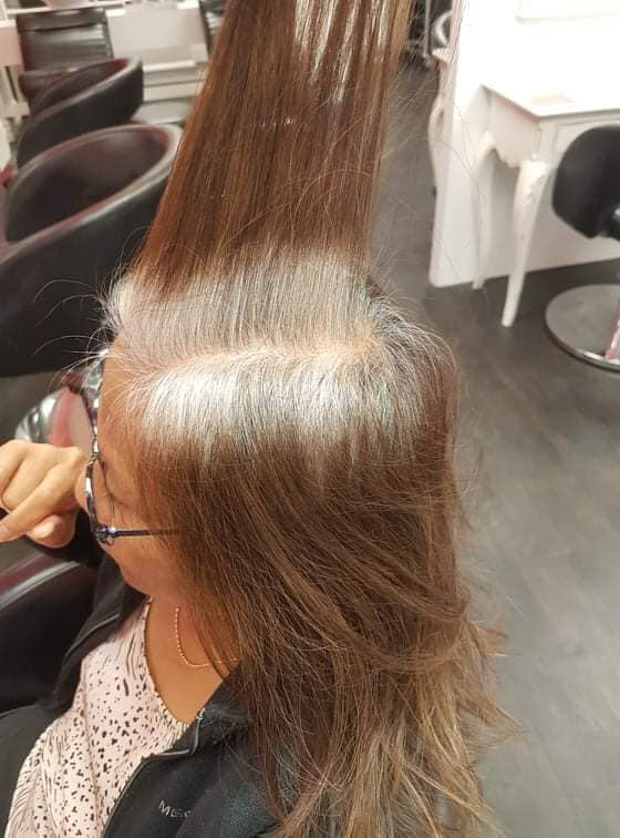 Damaged hair with grey roots